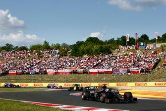 Romain Grosjean, Haas F1 Team VF-19, leads Nico Hulkenberg, Renault F1 Team R.S. 19, and Sergio Perez, Racing Point RP19