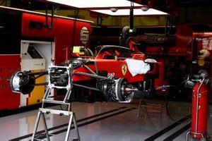 The car of Sebastian Vettel, Ferrari SF90, half built in the garage