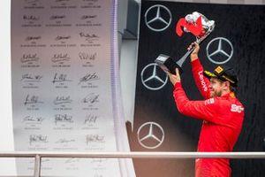 Sebastian Vettel, Ferrari, 2nd position, with his trophy