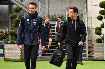 Alex Albon, Red Bull, and Lando Norris, McLaren, arrive at the circuit
