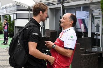 Romain Grosjean, Haas F1 speaks with Frederic Vasseur, Team Principal, Alfa Romeo Racing