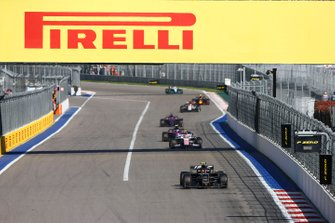 Kevin Magnussen, Haas F1 Team VF-19, leads Lance Stroll, Racing Point RP19, Pierre Gasly, Toro Rosso STR14, and Daniil Kvyat, Toro Rosso STR14