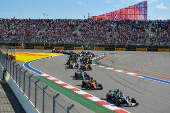 Lewis Hamilton, Mercedes AMG F1 W10, leads Carlos Sainz Jr., McLaren MCL34, Valtteri Bottas, Mercedes AMG W10, Lando Norris, McLaren MCL34, Sergio Perez, Racing Point RP19, and the remainder of the field at the start