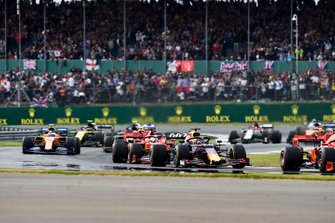 Max Verstappen, Red Bull Racing RB15, leads Sebastian Vettel, Ferrari SF90, and Lando Norris, McLaren MCL34, on the formation lap