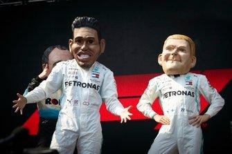 Caricatures of Lewis Hamilton, Mercedes AMG F1, and Valtteri Bottas, Mercedes AMG F1, on stage