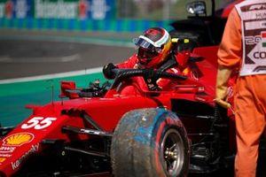 Carlos Sainz Jr., Ferrari SF21, climbs out of his car after crashing in Qualifying