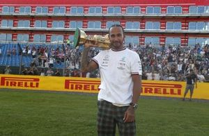 Race winner Lewis Hamilton, Mercedes, celebrates after the race with his trophy