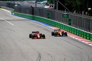Carlos Sainz Jr., Ferrari SF21, battles with Lando Norris, McLaren MCL35M