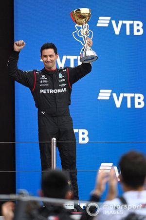 The Mercedes team representative lifts the Constructors trophy