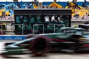Lance Stroll, Aston Martin AMR21, passes the Aston Martin team on the pit wall