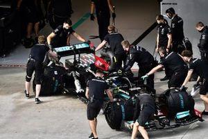 Valtteri Bottas, Mercedes W12, is returned to the garage