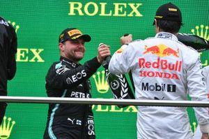 Valtteri Bottas, Mercedes, 1st position, and Sergio Perez, Red Bull Racing, 3rd position, congratulate each other on the podium