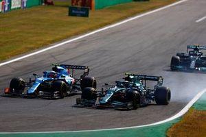 Esteban Ocon, Alpine A521, battles with Sebastian Vettel, Aston Martin AMR21