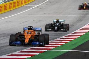 Carlos Sainz Jr., McLaren MCL35 and Valtteri Bottas, Mercedes F1 W11 EQ Performance