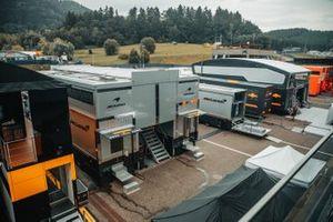 McLaren transporters in the paddock