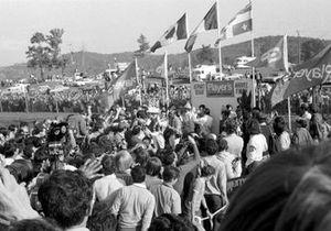Jacky Ickx, Ferrari 312B holds the winner trophy
