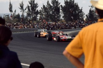 Chris Amon, March 701 Ford, leads Denny Hulme, McLaren M14A Ford