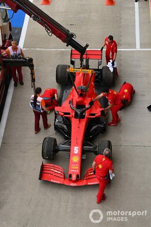 The car of Sebastian Vettel, Ferrari SF1000, is loaded onto a truck after a technical failure