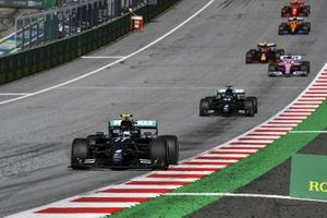 Valtteri Bottas, Mercedes F1 W11 EQ Performance, leads Lewis Hamilton, Mercedes F1 W11 EQ Performance, and Sergio Perez, Racing Point RP20