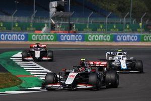 Kevin Magnussen, Haas VF-20, Nicholas Latifi, Williams FW43, and Romain Grosjean, Haas VF-20