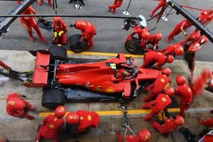 The Ferrari team make a practise pit stop using the Charles Leclerc Ferrari SF1000