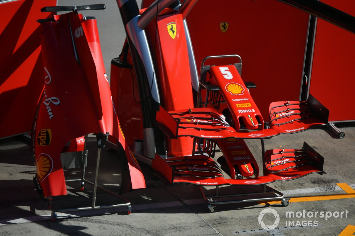 Bodywork in the pit lane outside of the Ferrari garage