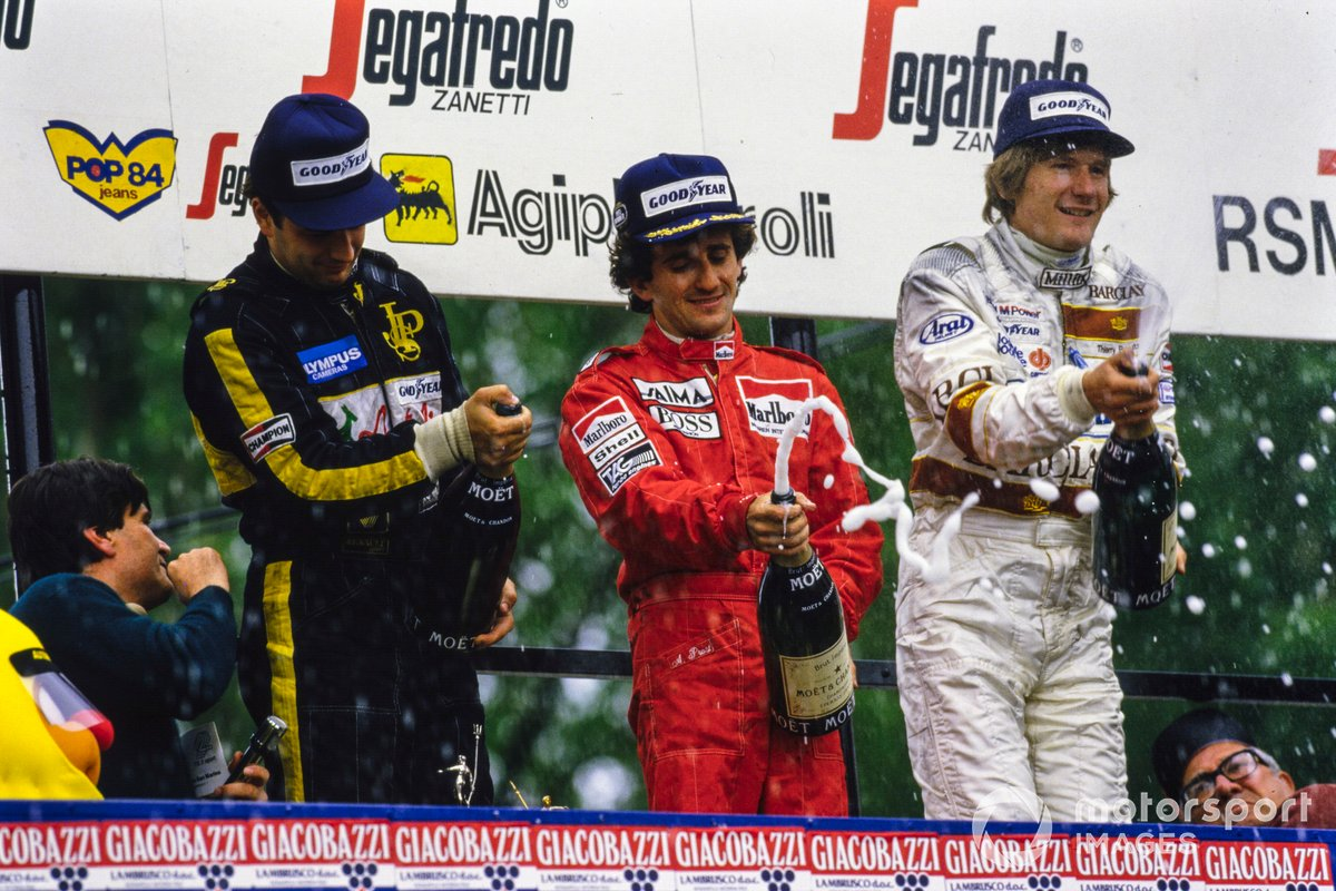 Podium: Second placed Elio De Angelis, Lotus, race winner Alain Prost, McLaren, third placed Thierry Boutsen, Arrows