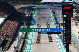 Max Verstappen, Red Bull Racing RB16B, and Lewis Hamilton, Mercedes W12, preapre to lead the field away at the start