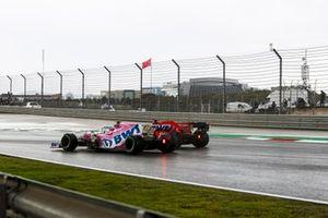 Sebastian Vettel, Ferrari SF1000, passes Lance Stroll, Racing Point RP20