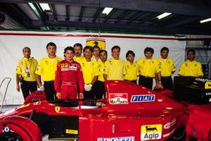 Jean Alesi with his Ferrari 643 and the team in the garage