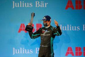 Mitch Evans, Panasonic Jaguar Racing, celebrates third position on the trophy