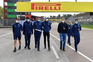 Nicholas Latifi, Williams, walks the track with members of his team