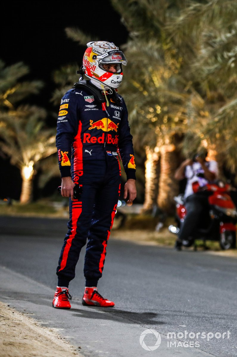 Max Verstappen, Red Bull Racing, stands by the side of the track after retiring