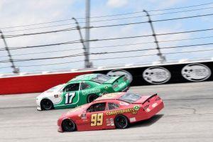 Ryan Ellis, B.J. McLeod Motorsports, Toyota Supra CorvetteParts.net and J.J. Yeley, SS Green Light Racing, Chevrolet Camaro WORKPRO
