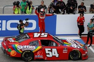Kyle Busch, Joe Gibbs Racing, Toyota Supra Skittles Gummies celebrates his victory
