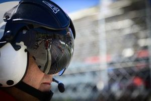 Sergio Perez, Red Bull Racing RB16B reflected in a fire marshal's visor
