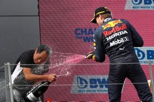 Toyoharu Tanabe, F1 Technical Director, Honda, is sprayed with Champagne on the podium by Max Verstappen, Red Bull Racing, 1st position