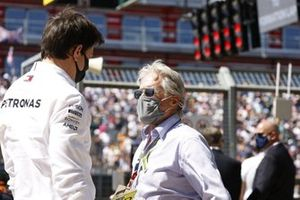 Toto Wolff, Team Principal and CEO, Mercedes AMG, and Michael Douglas on the grid