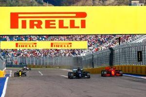Lewis Hamilton, Mercedes F1 W11, passes Sebastian Vettel, Ferrari SF1000
