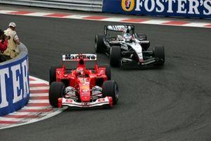 Michael Schumacher, Ferrari F2004 leads Kimi Raikkonen, McLaren Mercedes MP4/19B