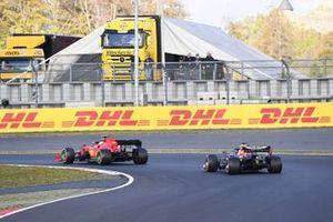 Charles Leclerc, Ferrari SF1000 and Max Verstappen, Red Bull Racing RB16