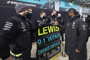 Lewis Hamilton, Mercedes-AMG F1, 1st position, celebrates with his team after securing his 91st F1 race win, equalling the record of Michael Schumacher