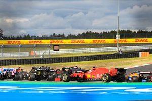 Esteban Ocon, Renault F1 Team R.S.20, Sebastian Vettel, Ferrari SF1000, and Lando Norris, McLaren MCL35, at the start