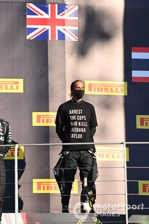 Lewis Hamilton, Mercedes-AMG F1, celebrates on the podium with Valtteri Bottas, Mercedes-AMG F1
