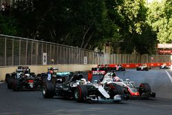 Lewis Hamilton, Mercedes AMG F1 W07 Hybrid and Romain Grosjean, Haas F1 Team VF-16 battle for positi