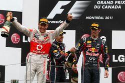 Jenson Button, McLaren Mercedes; Sebastian Vettel, Red Bull Racing; Mark Webber (AUS), Red Bull Raci