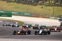 Max Verstappen, Red Bull Racing RB12; Sergio Perez, Sahara Force India F1 VJM09