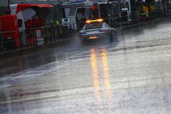 The FIA Safety Car heads down the pit lane as rain delays qualifying