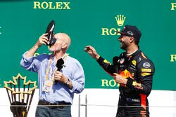 Sir Patrick Stewart drinks champagne from the shoe of Daniel Ricciardo, Red Bull Racing, on the podium