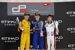 Podium: Race winner Jake Hughes, DAMS 2nd place Jack Aitken, Arden International and 3rd place Nirei